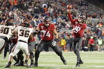 Washington State quarterback Anthony Gordon, right, throws a pass as offensive lineman Robert Valencia (74) blocks during the second half of the team's NCAA college football game against Oregon State, Saturday, Nov. 23, 2019, in Pullman, Wash. Washington State won 54-53. (AP Photo/Ted S. Warren)