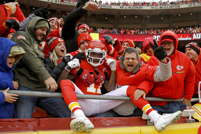 Kansas City Chiefs wide receiver Mecole Hardman (17) celebrates his kickoff return for a touchdown with fans during the second half of an NFL football game against the Los Angeles Chargers in Kansas City, Mo., Sunday, Dec. 29, 2019. (AP Photo/Charlie Riedel)