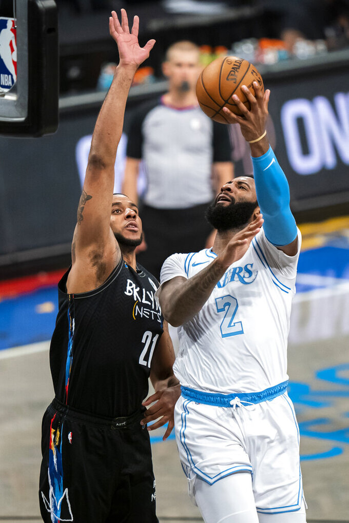 Los Angeles Lakers center Andre Drummond (2) shoots over Brooklyn Nets center LaMarcus Aldridge (21) during the second half of an NBA basketball game Saturday, April 10, 2021, in New York. (AP Photo/Corey Sipkin)