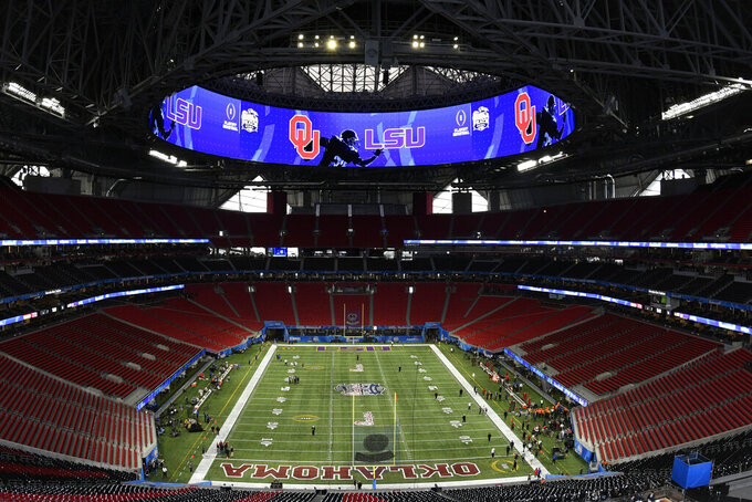 FILE - In this Dec. 28, 2019, file photo, the Mercedes-Benz stadium is shown prior to the Peach Bowl NCAA college football playoff game between LSU and Oklahoma in Atlanta. Chick-fil-A Peach Bowl president Gary Stokan is considering multiple contingency plans for three kickoff games planned in Atlanta, but there is one bottom line: If it's not safe for fans, the three games, Florida State-West Virginia, Georgia-Virginia and North Carolina-Auburn, won't be played at Mercedes-Benz Stadium (AP Photo/Danny Karnik, File)