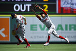 Boston Red Sox right fielder Mookie Betts, right, makes a catch on a ball it by Los Angeles Angels' Albert Pujols as second baseman Brock Holt gets out of the way during the first inning of a baseball game Sunday, Sept. 1, 2019, in Anaheim, Calif. (AP Photo/Mark J. Terrill)