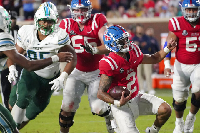 Mississippi quarterback Matt Corral (2) slides into a first down while being pursued by Tulane defenders during the first half of an NCAA college football game, Saturday, Sept. 18, 2021, in Oxford, Miss. (AP Photo/Rogelio V. Solis)