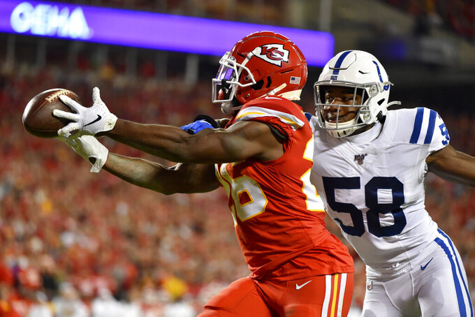Kansas City Chiefs running back Damien Williams (26) can't reach a pass in the end zone against the defense of Indianapolis Colts linebacker Bobby Okereke (58) during the first half of an NFL football game in Kansas City, Mo., Sunday, Oct. 6, 2019. (AP Photo/Ed Zurga)