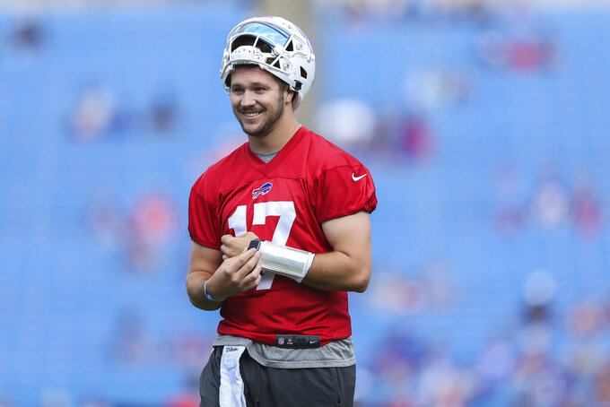 Buffalo Bills quarterback Josh Allen (17) smiles during practice at NFL football training camp in Orchard Park, N.Y., on Saturday, July 31, 2021. (AP Photo/Joshua Bessex)