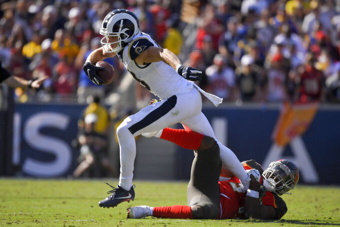 Los Angeles Rams wide receiver Cooper Kupp is tackled by Tampa Bay Buccaneers safety Mike Edwards during the second of an NFL football game Sunday, Sept. 29, 2019, in Los Angeles. (AP Photo/Mark J. Terrill)
