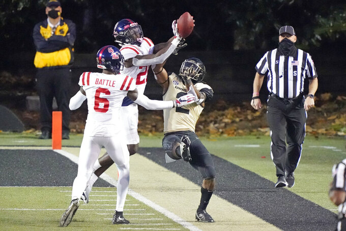 Mississippi defensive backs Miles Battle (6) and A.J. Finley (21) break up a pass intended for Vanderbilt wide receiver Amir Abdur-Rahman (2) in the second half of an NCAA college football game Saturday, Oct. 31, 2020, in Nashville, Tenn. Mississippi won 54-21. (AP Photo/Mark Humphrey)