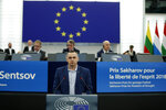 Ukrainian filmmaker Oleg Sentsov delivers his speech at the European Parliament Tuesday Nov. 26, 2019 in Strasbourg, eastern France. A year after he won Europe's top human rights award, Oleg Sentsov finally picked up the prize, following his release from a prison in Russia's far-north where he was held on terror charges. (AP Photo/Jean-Francois Badias)