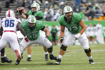 Marshall offensive lineman Alex Mollette (55) and Josh Ball (79) pop of the line of scrimmage on the snap as the Herd takes on Florida Atlantic during an NCAA college football game on Saturday, Oct. 24, 2020, at Joan C. Edwards Stadium Huntington, W.Va. (Sholten Singer/The Herald-Dispatch via AP)