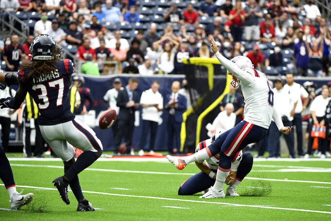 New England Patriots place kicker Nick Folk (6) kicks a game-winning field goal against the Houston Texans during the second half of an NFL football game Sunday, Oct. 10, 2021, in Houston. The Patriots won 25-22. (AP Photo/Justin Rex)