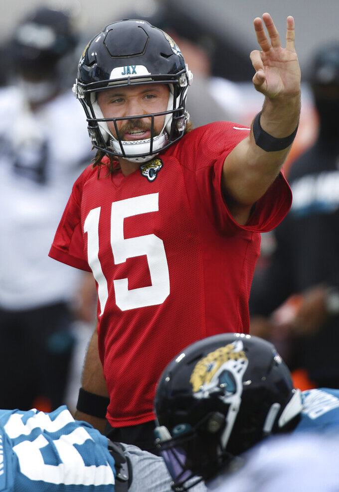 Jacksonville Jaguars starting quarterback Gardner Minshew II signals a play during NFL football training camp, Saturday, Aug. 29, 2020, in Jacksonville, Fla. (Bob Self/The Florida Times-Union via AP)