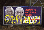 FILE- In this Feb. 26, 2019, file photo, a billboard from a campaign of the Hungarian government showing EU Commission President Jean-Claude Juncker and Hungarian-American financier George Soros with the caption