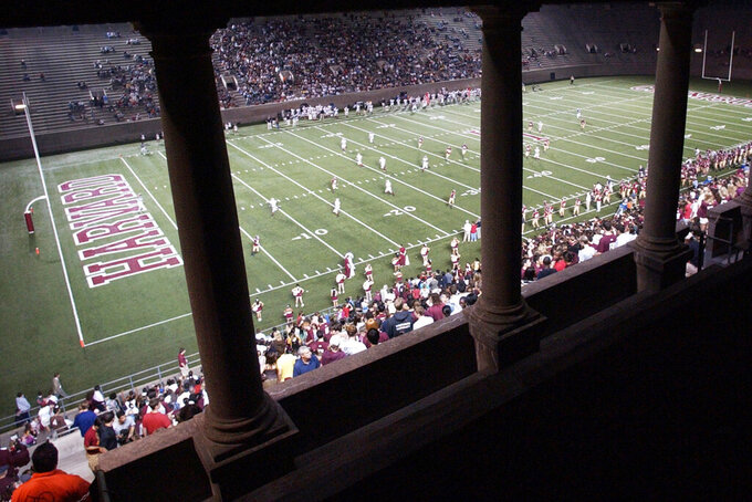 FILE - In this Sept. 22, 2007 file photograph, fans watch the Harvard football team playing Brown in Cambridge, Mass., at historic Harvard Stadium. The stadium has hosted the team's home games for more than a century, including their famed 1919/1920 season. Harvard's 7-6 victory over Oregon in the Jan. 1, 1920, Tournament East-West Football Game, a precursor to the Rose Bowl, was the only postseason appearance in the Ivy League school's century and a half of football. (AP Photo/Lisa Poole, File)
