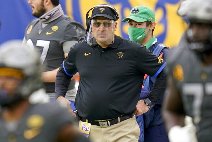 Pittsburgh head coach Pat Narduzzi wears a face shield as he watches his team play against Notre Dame during the first half of an NCAA college football game, Saturday, Oct. 24, 2020, in Pittsburgh. (AP Photo/Keith Srakocic)