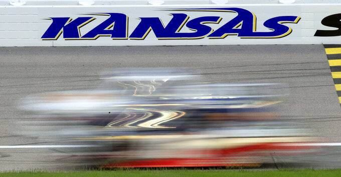 Drivers race past the start/finish line during the NASCAR Truck Series auto race at Kansas Speedway in Kansas City, Kan., Friday, May 10, 2019. (AP Photo/Orlin Wagner)