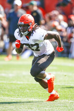 Cleveland Browns running back Kareem Hunt runs through a drill during practice at the NFL football team's training facility Monday, Aug. 5, 2019, in Berea, Ohio. (AP Photo/Ron Schwane)