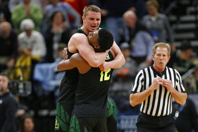 Baylor guard Makai Mason, left, and guard Jared Butler (12) celebrate the team's win against Syracuse in a first-round game in the NCAA men's college basketball tournament Thursday, March 21, 2019, in Salt Lake City. (AP Photo/Jeff Swinger)