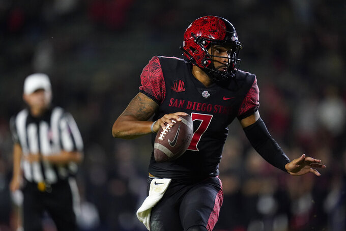 San Diego State quarterback Lucas Johnson (7) runs the ball during overtime of an NCAA college football game against Utah Saturday, Sept. 18, 2021, in Carson, Calif. (AP Photo/Ashley Landis)