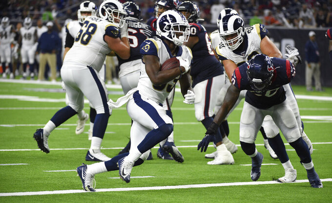 Los Angeles Rams running back Justin Davis, left, rushes for a touchdown against the Houston Texans during the second half of a preseason NFL football game Thursday, Aug. 29, 2019, in Houston. (AP Photo/Eric Christian Smith)