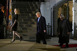 Amy Coney Barrett, from left, President Donald Trump and Supreme Court Justice Clarence Thomas walk onstage for a ceremony on the South Lawn of the White House in Washington, Monday, Oct. 26, 2020, after Barrett was confirmed by the Senate earlier in the evening. (AP Photo/Patrick Semansky)