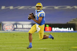 UCLA quarterback Chase Griffin runs against Arizona during the first half of an NCAA college football game Saturday, Nov. 28, 2020, in Pasadena, Calif. (AP Photo/Marcio Jose Sanchez)