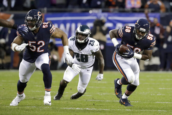 Chicago Bears linebacker Roquan Smith (58) runs after intercepting a pass intended for Philadelphia Eagles running back Wendell Smallwood (28) during the first half of an NFL wild-card playoff football game against the Philadelphia Eagles Sunday, Jan. 6, 2019, in Chicago. Smith was ruled down at the point of the interception. (AP Photo/Nam Y. Huh)