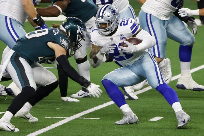 Philadelphia Eagles linebacker Alex Singleton (49) moves in to make the stop against Dallas Cowboys running back Ezekiel Elliott (21) in the second half of an NFL football game in Arlington, Texas, Sunday, Dec. 27. 2020. (AP Photo/Michael Ainsworth)