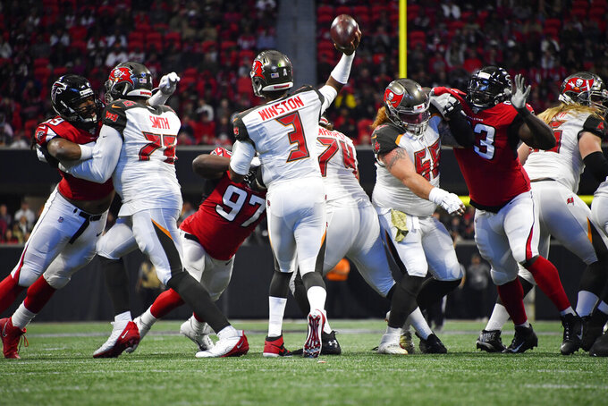 Tampa Bay Buccaneers quarterback Jameis Winston (3) works in the pocket against the Atlanta Falcons during the first half of an NFL football game, Sunday, Nov. 24, 2019, in Atlanta. (AP Photo/John Amis)