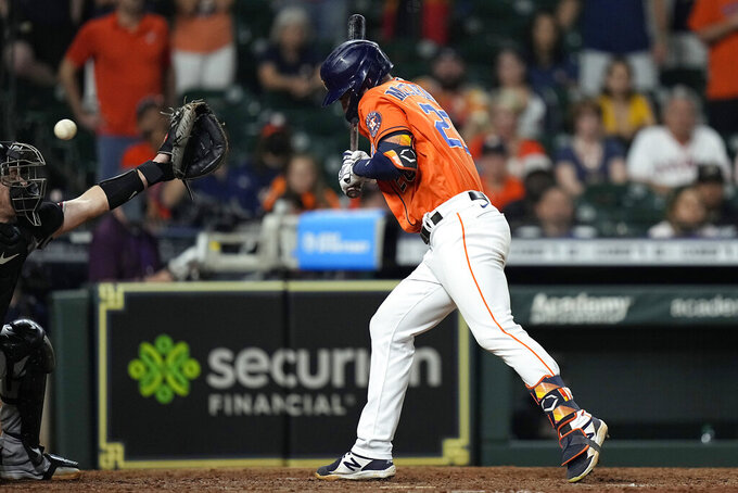 Houston Astros' Chas McCormick (20) is hit by a pitch with the bases loaded as Arizona Diamondbacks catcher Carson Kelly reaches for the ball during the 10th inning of a baseball game Friday, Sept. 17, 2021, in Houston. The Astros won 4-3. (AP Photo/David J. Phillip)