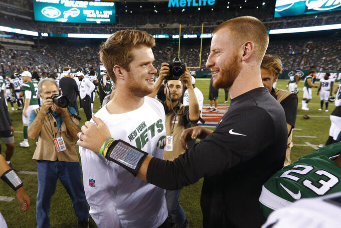 Philadelphia Eagles' Carson Wentz, right, talks to New York Jets quarterback Sam Darnold after a preseason NFL football game Thursday, Aug. 29, 2019, in East Rutherford, N.J. (AP Photo/Jim McIsaac)