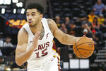 Cleveland Cavaliers Naz Mitrou-Long (15) brings the ball up court against the San Antonio Spurs during the second half of an NBA summer league game Monday, July 1, 2019, in Salt Lake City. (AP Photo/Rick Bowmer)