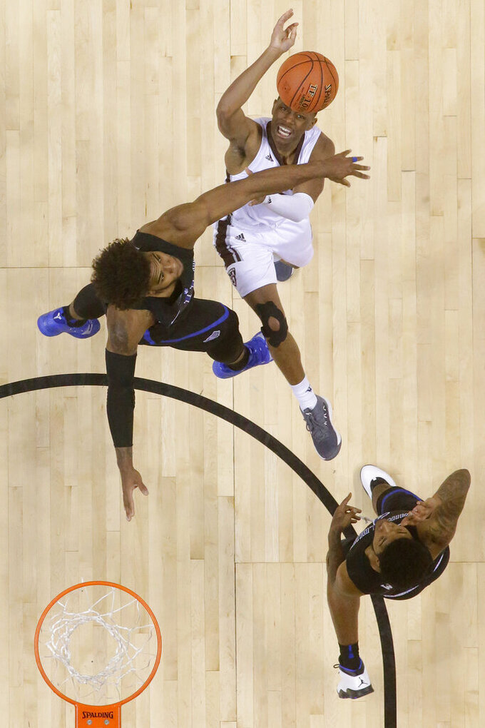 St. Bonaventure guard Kyle Lofton, top right, competes for the rebound with Saint Louis forward Hasahn French, left, and guard Dion Wiley during the second half of an NCAA college basketball game in the Atlantic 10 men's tournament final Sunday, March 17, 2019, in New York. Saint Louis won 55-53. (AP Photo/Julio Cortez)