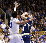 Duke's Tre Jones (3) guards Georgia Tech's Jose Alvarado (10) during the first half of an NCAA college basketball game in Durham, N.C., Saturday, Jan. 26, 2019. (AP Photo/Gerry Broome)