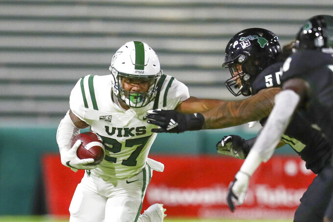 Portland State running back Malik Walker (27) stiff arms Hawaii defensive lineman Justus Tavai (50) as he runs the ball during the first half of an NCAA college football game, Saturday, Sept. 4, 2021, in Honolulu. (AP Photo/Darryl Oumi)