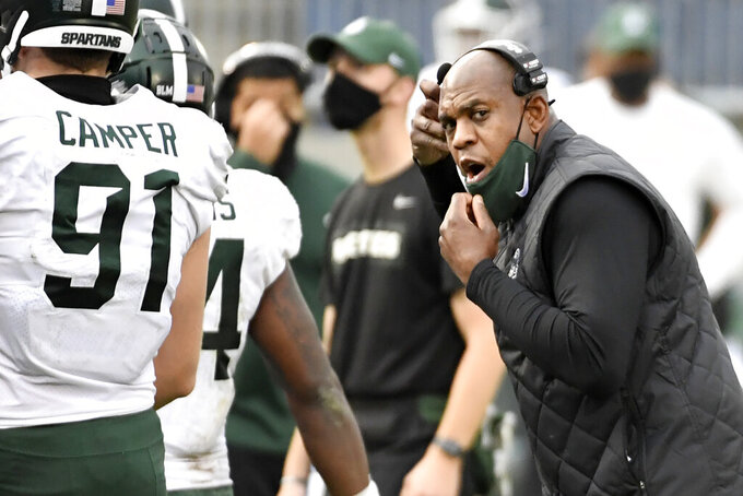 Michigan State head coach Mel Tucker talks to defensive end Jack Camper (91) during an NCAA college football game against Penn State in State College, Pa., on Saturday, Dec. 12, 2020. Penn State defeated Michigan State 39-24. (AP Photo/Barry Reeger)