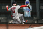 Boston Red Sox right fielder Alex Verdugo cannot catch a fly ball off the bat of Atlanta Braves' Adeiny Hechavarria during the eighth inning of a baseball game Friday, Sept. 25, 2020, in Atlanta. (AP Photo/John Amis)