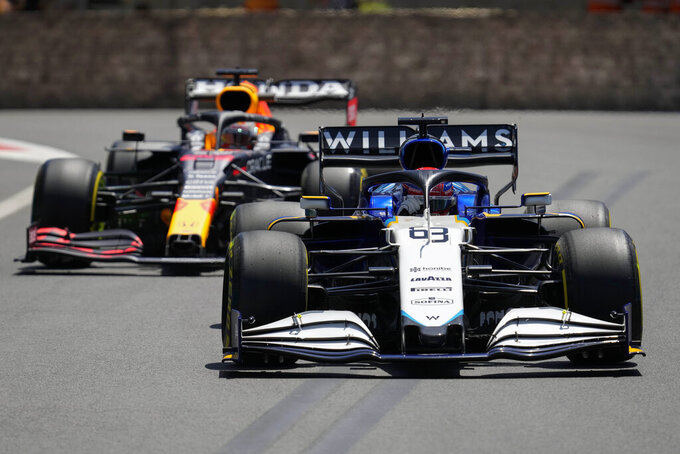 Williams driver George Russell of Britain leads Red Bull driver Max Verstappen of the Netherlands during the first free practice at the Baku Formula One city circuit, in Baku, Azerbaijan, Friday, June 4, 2021. The Formula one race will be held on Sunday. (AP Photo/Darko Vojinovic)