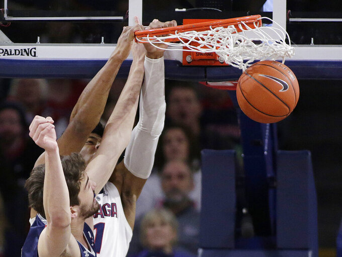 Gonzaga forward Rui Hachimura, back, dunks while defended by Saint Mary's center Jordan Hunter during the first half of an NCAA college basketball game in Spokane, Wash., Saturday, Feb. 9, 2019. (AP Photo/Young Kwak)