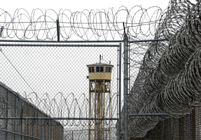 FILE - In this Feb. 25, 2015, file photo, a watch tower at the Utah State Correctional Facility in Draper, Utah. The Utah State Prison in Draper and the Central Utah Correctional Facility in Gunnison have been placed under a 24-hour lockdown after authorities believe the general inmate populations were exposed to COVID-19. The state Department of Corrections tells The Deseret News that the facilities went into lockdown Wednesday, Sept. 23, 2020, around 3 p.m. (AP Photo/Rick Bowmer, Pool, File)