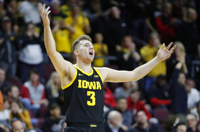 Iowa's Jordan Bohannon (3) celebrates as his team leads against Texas Tech during the second half of an NCAA college basketball game Thursday, Nov. 28, 2019, in Las Vegas. (AP Photo/John Locher)