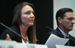 Courtney Wild, left, joined by her attorney Brad Edwards, reads a statement during a news conference, calling on victims of Jeffrey Epstein to contact the FBI or lawyers with their information, Tuesday July 16, 2019, in New York. (AP Photo/Bebeto Matthews)