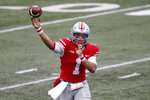 Ohio State quarterback Justin Fields throws a pass against Indiana during the second half of an NCAA college football game Saturday, Nov. 21, 2020, in Columbus, Ohio. Ohio State beat Indiana 42-35. (AP Photo/Jay LaPrete)