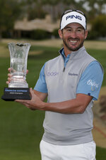 Andrew Landry holds his trophy after winning The American Express golf tournament on the Stadium Course at PGA West in La Quinta, Calif., Sunday, Jan. 19, 2020. (AP Photo/Alex Gallardo)