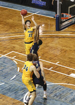 North Dakota State guard Jarius Cook (11) shoots the ball over an Oral Roberts defender during the first half of an NCAA college basketball game for the Summit League men's tournament championship Tuesday, March 9, 2021, in Sioux Falls, S.D. (AP Photo/Josh Jurgens)