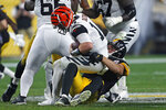 Pittsburgh Steelers outside linebacker T.J. Watt (90) sacks Cincinnati Bengals quarterback Andy Dalton (14) during the second half of an NFL football game in Pittsburgh, Monday, Sept. 30, 2019. (AP Photo/Tom Puskar)