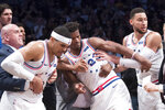 CORRECTS TO SECOND HALF NOT FIRST HALF - Philadelphia 76ers guard Jimmy Butler (23) is restrained after getting into a shoving match during the second half of Game 4 of a first-round NBA basketball playoff series against the Brooklyn Nets, Saturday, April 20, 2019, in New York. (AP Photo/Mary Altaffer)