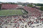 Georgia fans in red fill the majority of the seats in the first half of an NCAA college football game against Vanderbilt Saturday, Sept. 25, 2021, in Nashville, Tenn. (AP Photo/Mark Humphrey)