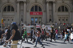Protesters march past the Metropolitan Museum during a solidarity rally for George Floyd, Saturday, May 30, 2020, in New York. Demonstrators took to the streets of New York City to protest the death of Floyd, a black man who died after being taken into police custody in Minneapolis on Memorial Day. (AP Photo/Wong Maye-E)