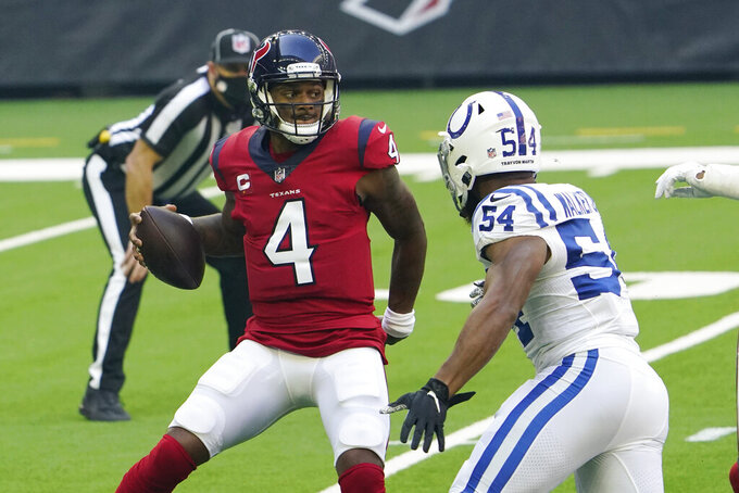 Houston Texans quarterback Deshaun Watson (4) is pressured by Indianapolis Colts middle linebacker Anthony Walker (54) during the first half of an NFL football game Sunday, Dec. 6, 2020, in Houston. (AP Photo/David J. Phillip)