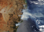 This NASA Modis satellite image provided by Maxar shows smoke from wildfires burning in in New South Wales, Australia, Thursday, Nov. 14, 2019. About 60 fires were burning around New South Wales on Thursday morning, with 27 uncontained while being battled by more than 1,000 firefighters, the Rural Fire Service said. (NASA/Satellite image ©2019 Maxar Technologies via AP)