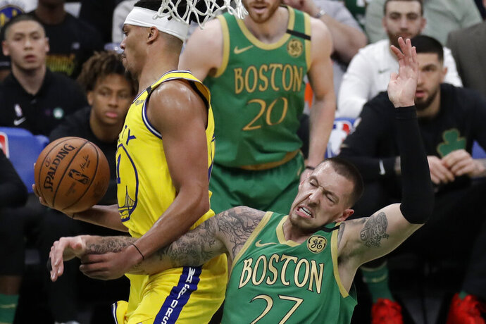 Boston Celtics center Daniel Theis (27) falls while becoming entangled with Golden State Warriors guard Damion Lee, left, during the first quarter of an NBA basketball game Thursday, Jan. 30, 2020, in Boston. (AP Photo/Elise Amendola)